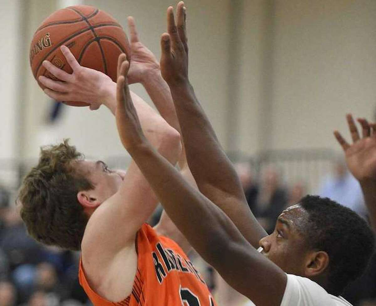 James St. Pierre scored a game-high 23 points as Ridgefield beat Trumbull in the FCIAC semifinals. Photo: Erik Trautmann / Hearst Connecticut Media
