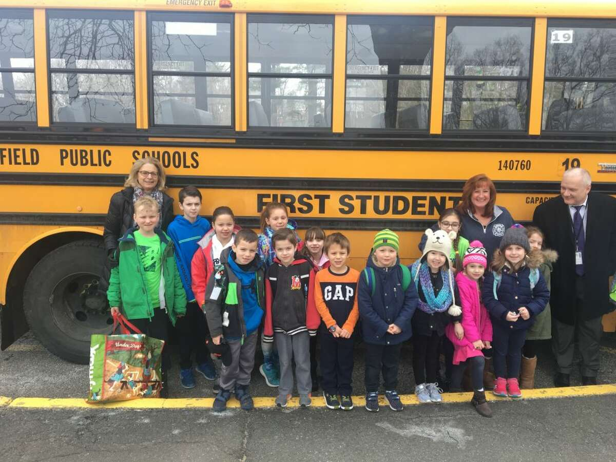 New superintendent Dr. Williams Collins rode the bus with Farmingville elementary students Feb. 19. It was his second day as the school district's top officials.