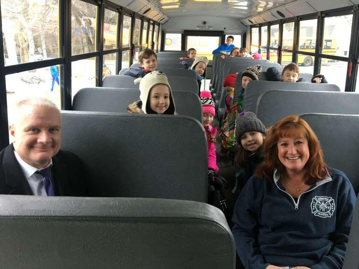 New superintendent Dr. Williams Collins with Farmingville bus drive Sharon Scott.
