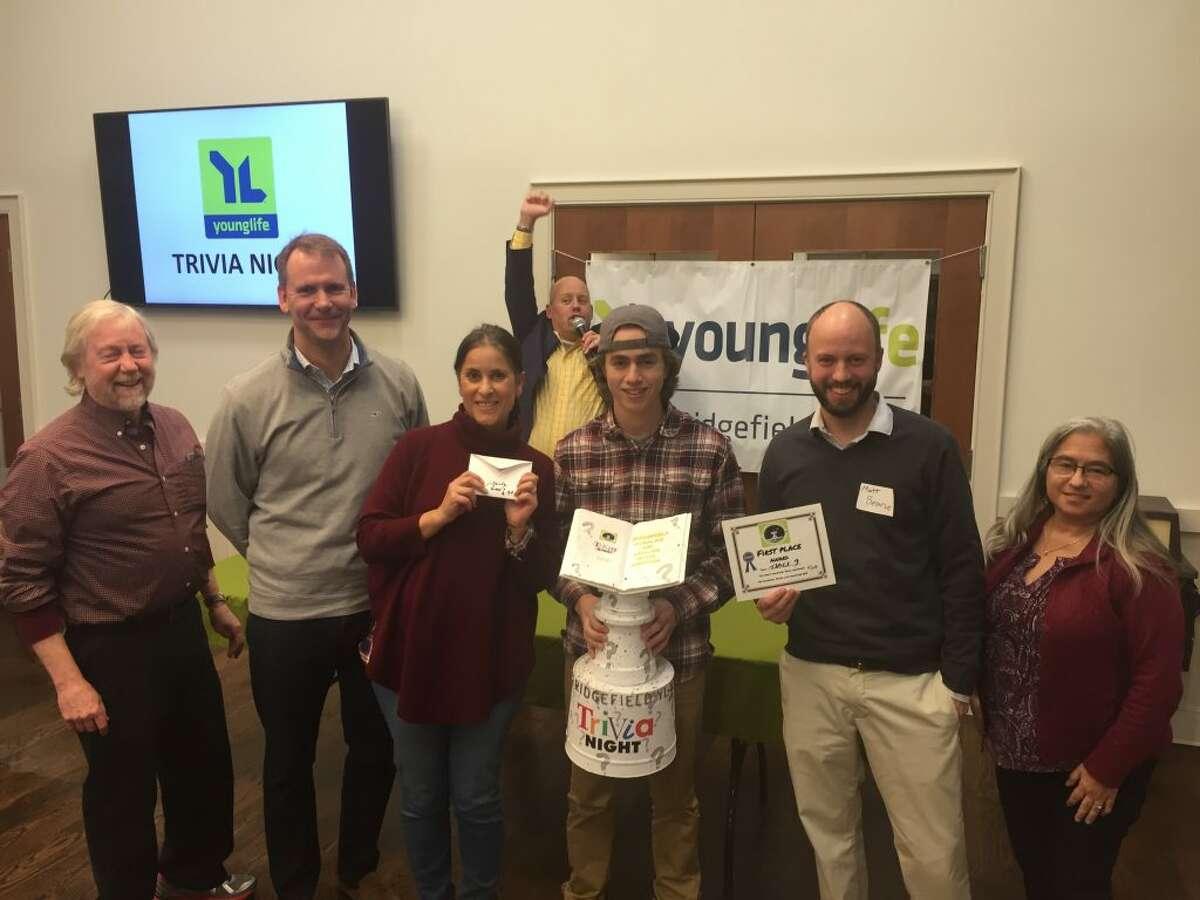 The 2018 Young Life and Wyldlife trivia night winning team. Left to right: John Mackenzie, Todd Petty, Caroline Heiser, Bob Cousins, Mark Mackenzie, Matt Bearse, and Sandy Mackenzie.