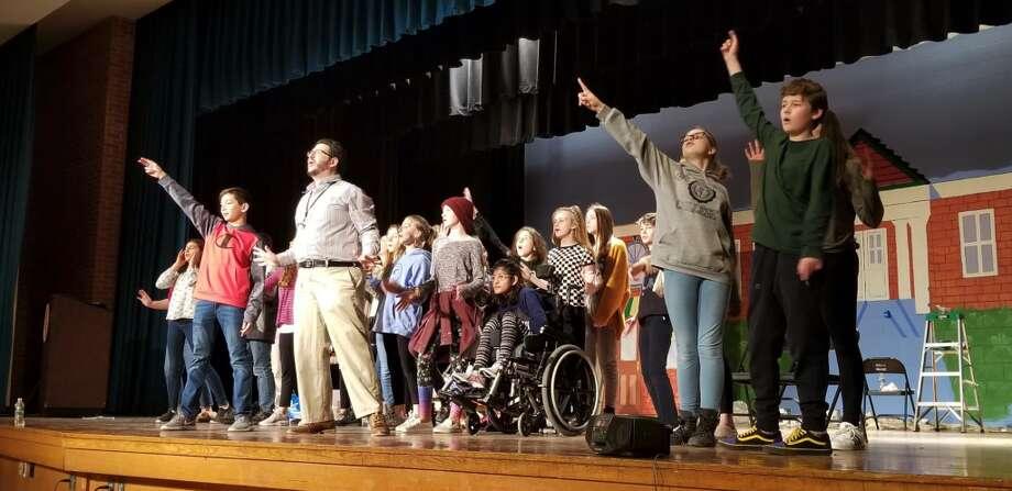 Director Jacob Litt leads the ensemble of The Music Man Jr. in a choreography rehearsal.