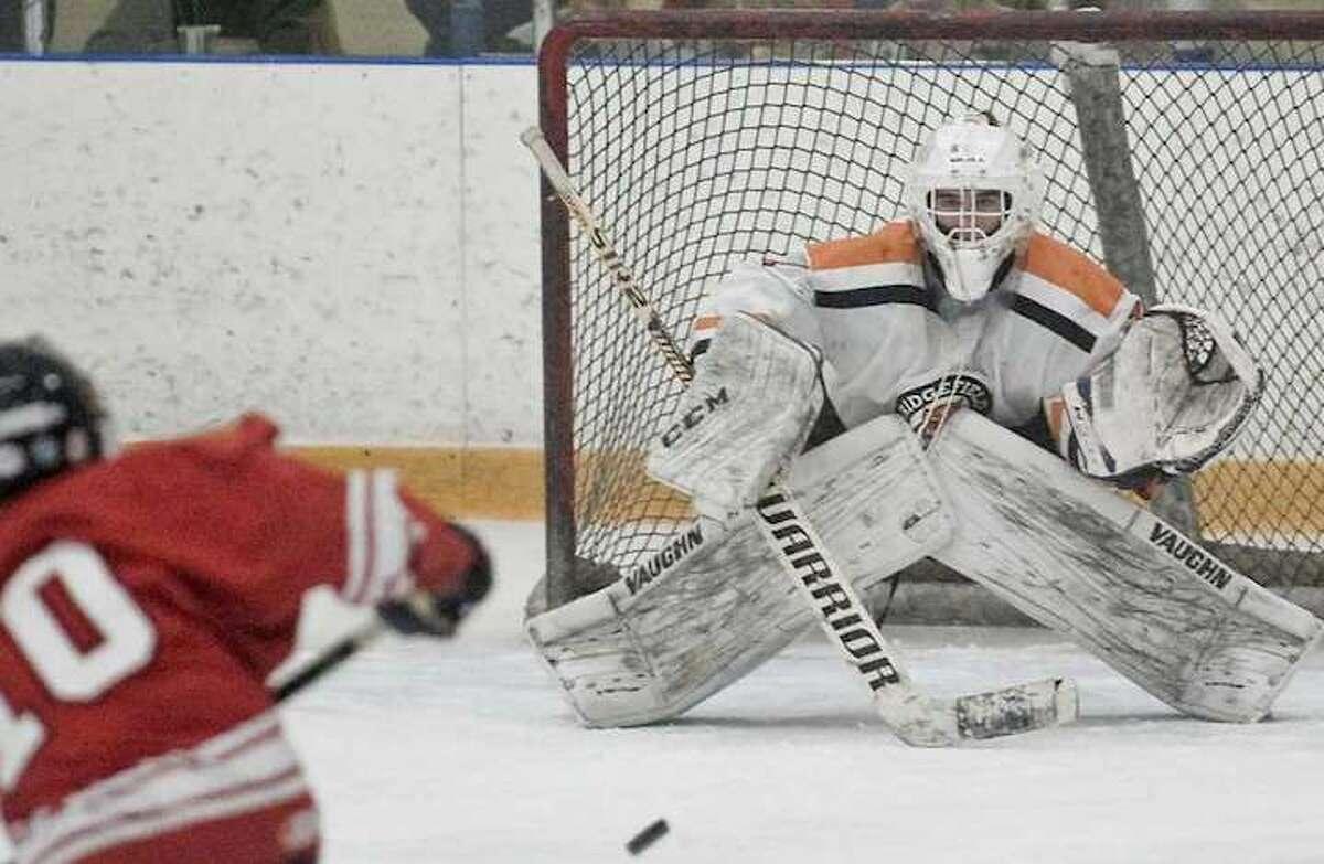 Goalie Sean Gordon and the Ridgefield boys hockey team take a 20-0-0 record into the postseason. Photo: Scott Mullin / Hearst Connecticut Media