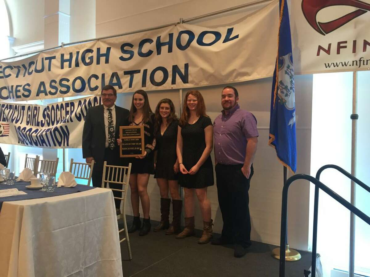 The Ridgefield High School girls soccer team was awarded the 2018 Connecticut Team of the Year at the annual Connecticut Girls Soccer Association (CGSA) banquet on Feb. 10. Players Claire Middlebrook, Caitlin Slaminko, and Lauren Castle, pictured above with CGSA President and RHS coach Iain Golding, were named to First Team All State.