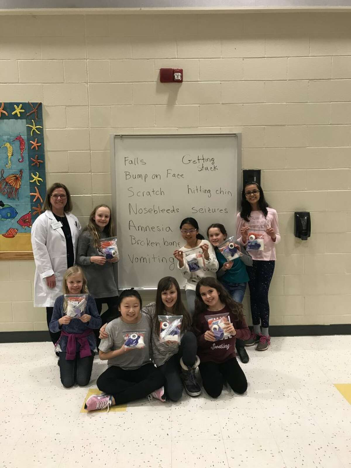 Pictured, from left to right: Dr. Lynne Savino, Camryn Art, Charlotte Fandrick, Stella Yi, Maura McGuire, Sophie Heitner, Cece Gu, Zella Bunch, and Aayushi Dabi. Not shown: Ashley Zettl and Emily Honore.