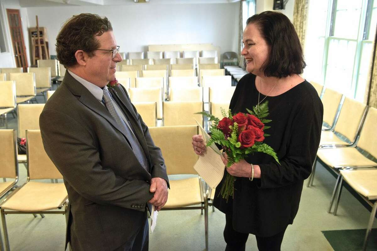 Sara and John Lowenstine, of Ridgefield, renewed their wedding vows on the fifth anniversary of their Valentine's Day wedding with the help of Justice of the Peace Mark Robinson, in Ridgefield Town Hall, Ridgefield, Conn, on Thursday, Feb. 14, 2019. - H. John Voorhees