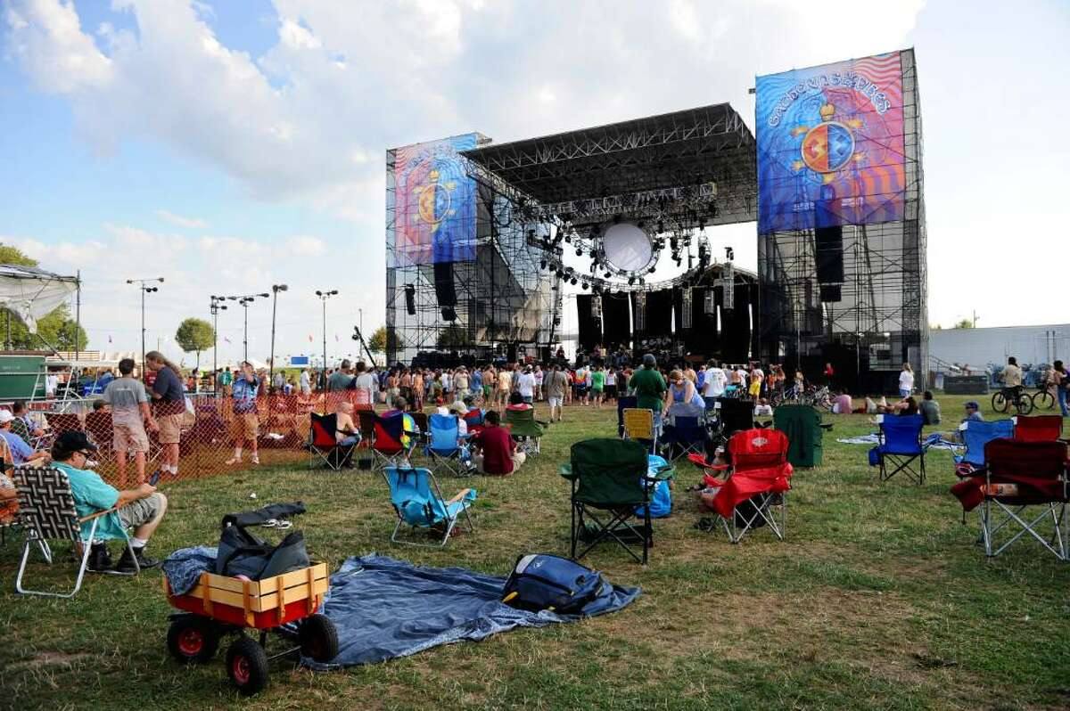 Concert-goers relax on the grass in front of the main stage during the Gathering of the Vibes at Seaside Park on Thursday, July 29, 2010.