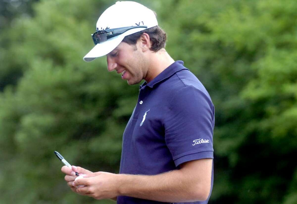 David Pastore, of Greenwich, marks his ball at the 2010 Met Amateur Championship at Quaker Ridge Golf Club, Scarsdale, N.Y., on Thursday, July 29, 2010.