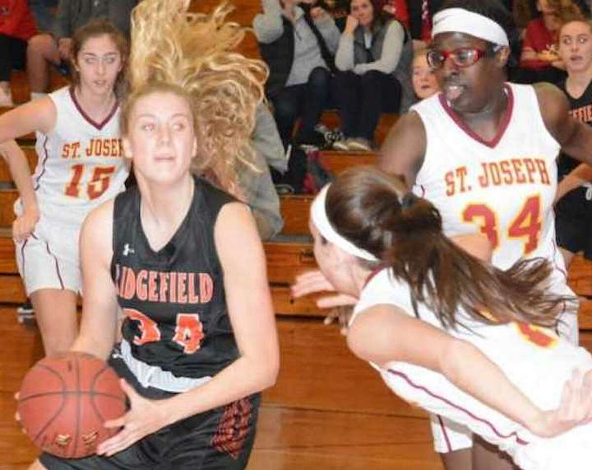 Kate Garson eyes the basket during Ridgefield's win over St. Joseph. - Andy Hutchison photo