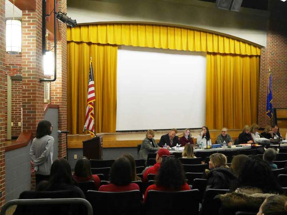 Ridgefield High School senior Anna Lourenso speaks about proposed art cuts during Saturday's Board of Education budget hearing. Lourenso said the district's art program helped her process the death of her father — a subject she wrote about in her college essay to Pratt, which she will attend in the fall. — Peter Yankowski photo