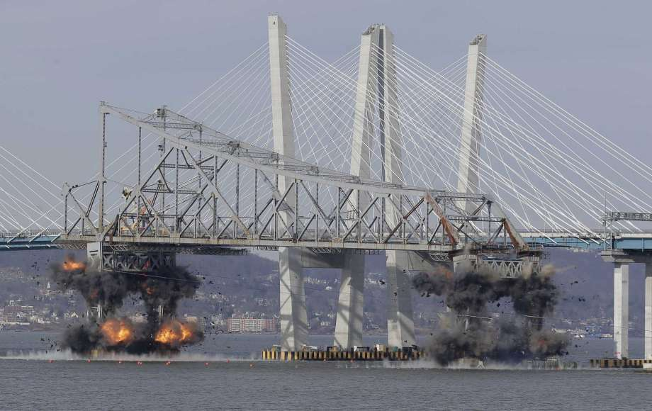 A section of the old Tappan Zee Bridge is brought down with explosives in this view from Tarrytown, N.Y., Tuesday, Jan. 15. The blast was reportedly heard on Silver Spring Road. — Seth Wenig, AP