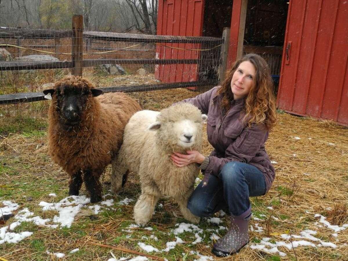 Farmer Whitney Freeman and her sheep at Henny Penny Farm. - Mack Reid photo