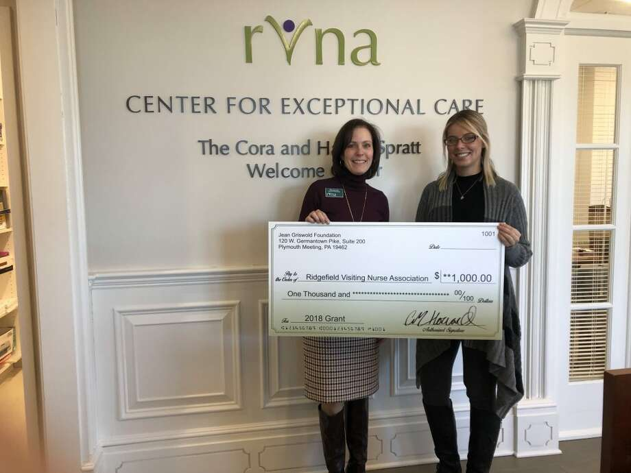 Mary Jean Heller, director of philanthropy for the RVNA, receives a $1,000 grants check from Kelly Coy, case manager at Griswold Home Care.