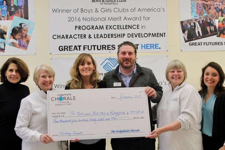 Annette Hewko, Amy Y. Day, Jess Murphy, Mike Flynn, Daniela Sikora, and Tauna Idone stand together with the check from the Ridgefield Chorale to the Boys and Girls Club.
