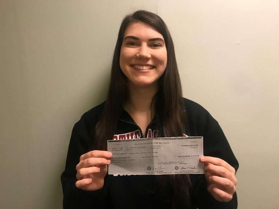 Ridgefield High School graduate Abby Fennell with a $15,000 grant check that the state's Office of Economic and Community Development awarded to CHIRP. Ridgefield's concert park series returns in May for its 18th year.