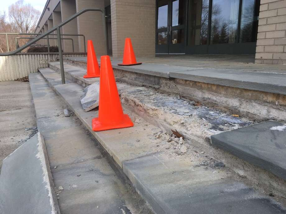 The front steps at East Ridge Middle School have become one of the targets of infrastructure repairs needed across the town's nine public schools. — Peter Yankowski photo