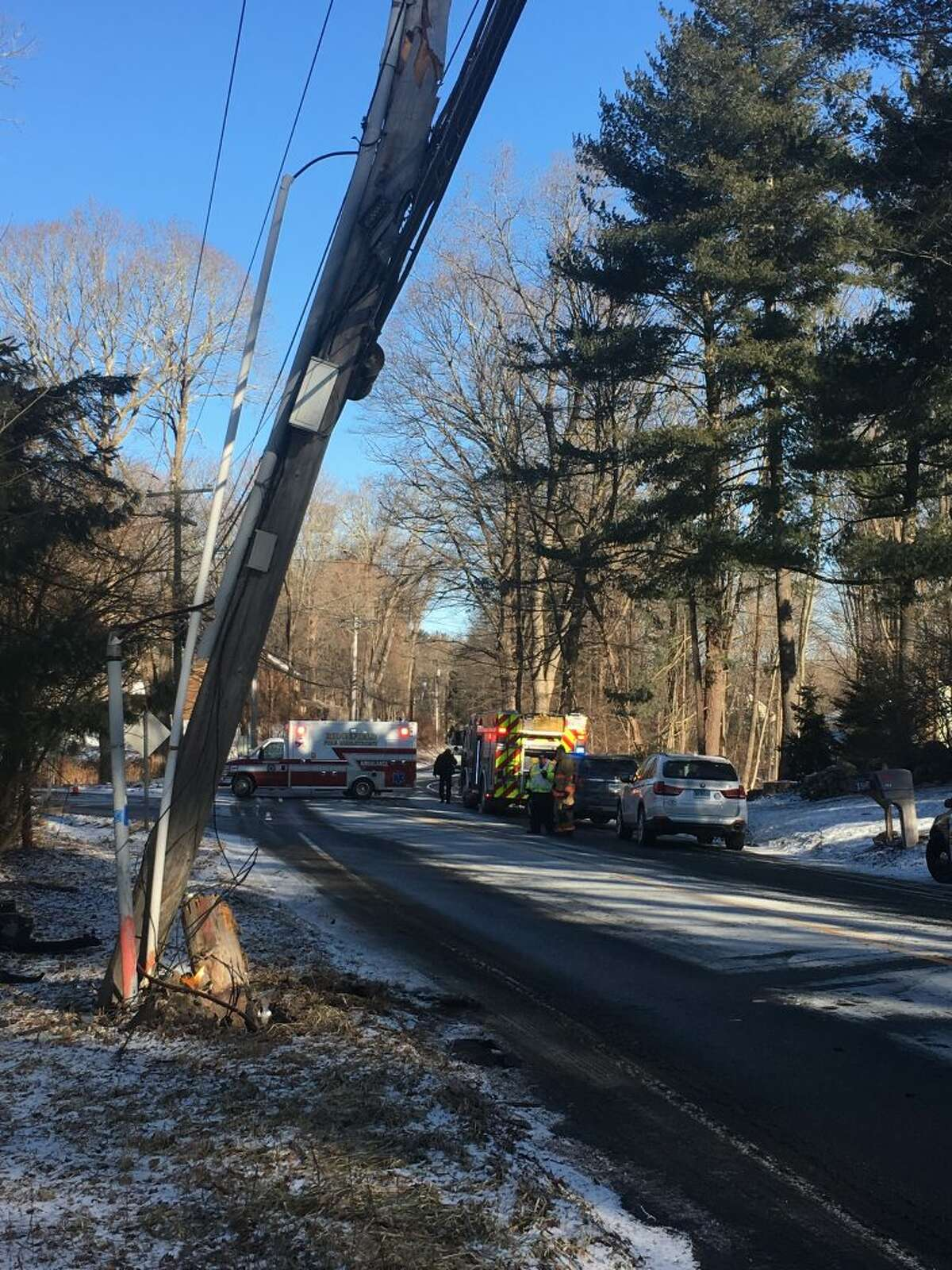 Police closed off part of Route 116 Thursday, Jan. 31 after a car crashed into a utility pole. - Steve Coulter photo