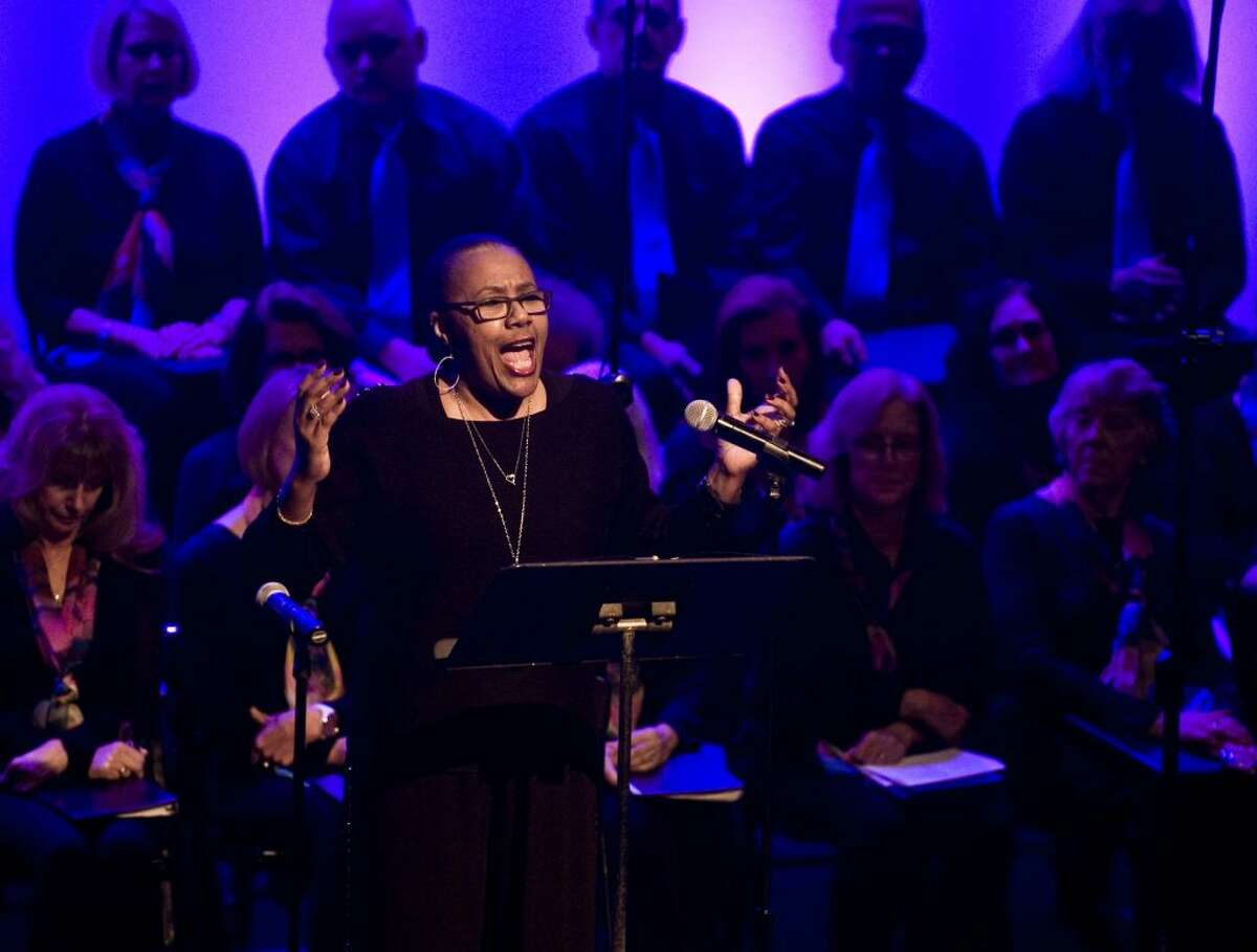 """Kimberly Wilson reads excerpts from MLK's """"I Have A Dream"""" speech during the annual Martin Luther King Jr. Day ceremony at the Playhouse Monday afternoon. - Scott Mullin photo"""