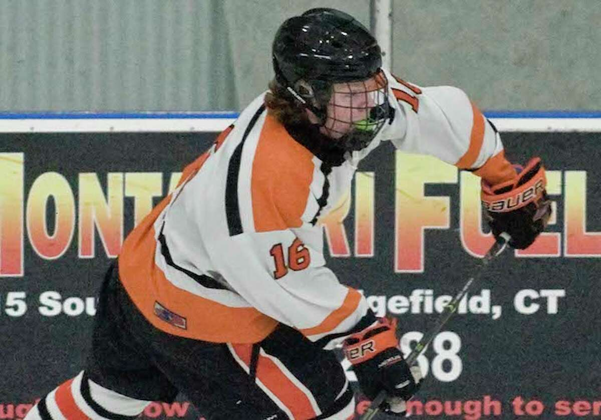 Kevin McNicholas and the Ridgefield High boys hockey team stayed unbeaten with a 5-2 win over Greenwich. - Scott Mullin photo