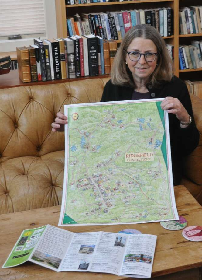 The Ridgefield Visitors' Map, spearheaded by Books on the Common owner Ellen Burns, features artist Bart Arnold's drawings of town landmarks and locations. — Macklin Reid photo