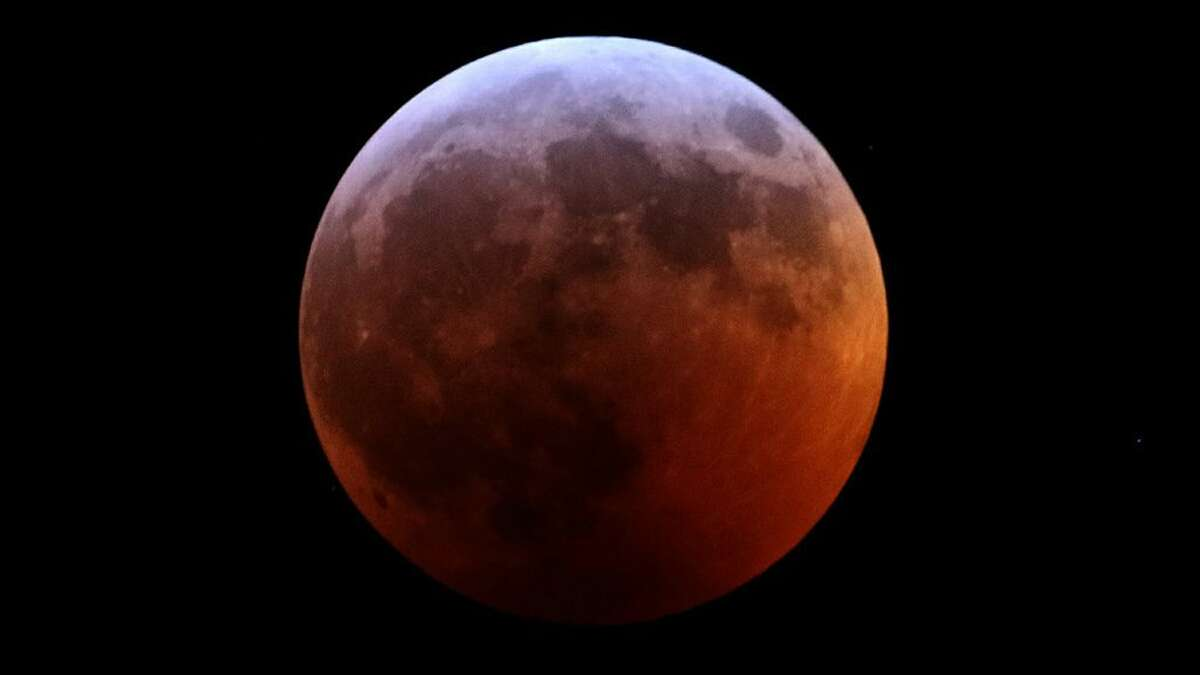 """Ridgefield High School graduate Garry Kessler, class of 1968, captured the Lunar Eclipse Sunday, Jan. 20, above his home in Westborough, Mass. """"It was five degrees and falling fast,"""" Kessler said of the conditions of the photo, which was snapped at 11:46 p.m. The Lunar Eclipse, known alternatively as the Super Blood Wolf Moon, was visible in North America, South America, western Europe, and northwestern Africa."""