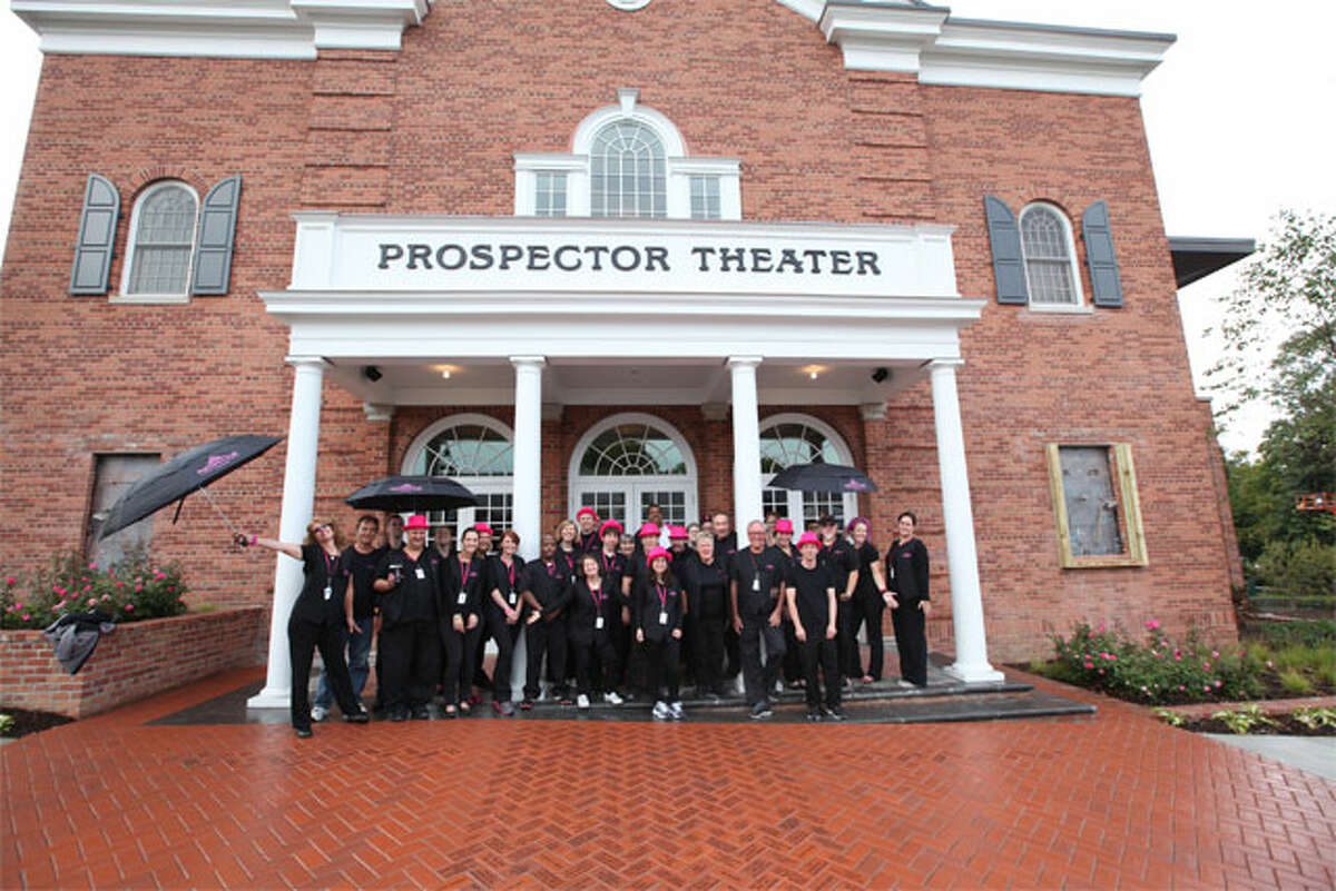 The Prospector Team pose in front of Ridgefield's moviehouse before the theater's grand opening in 2014.
