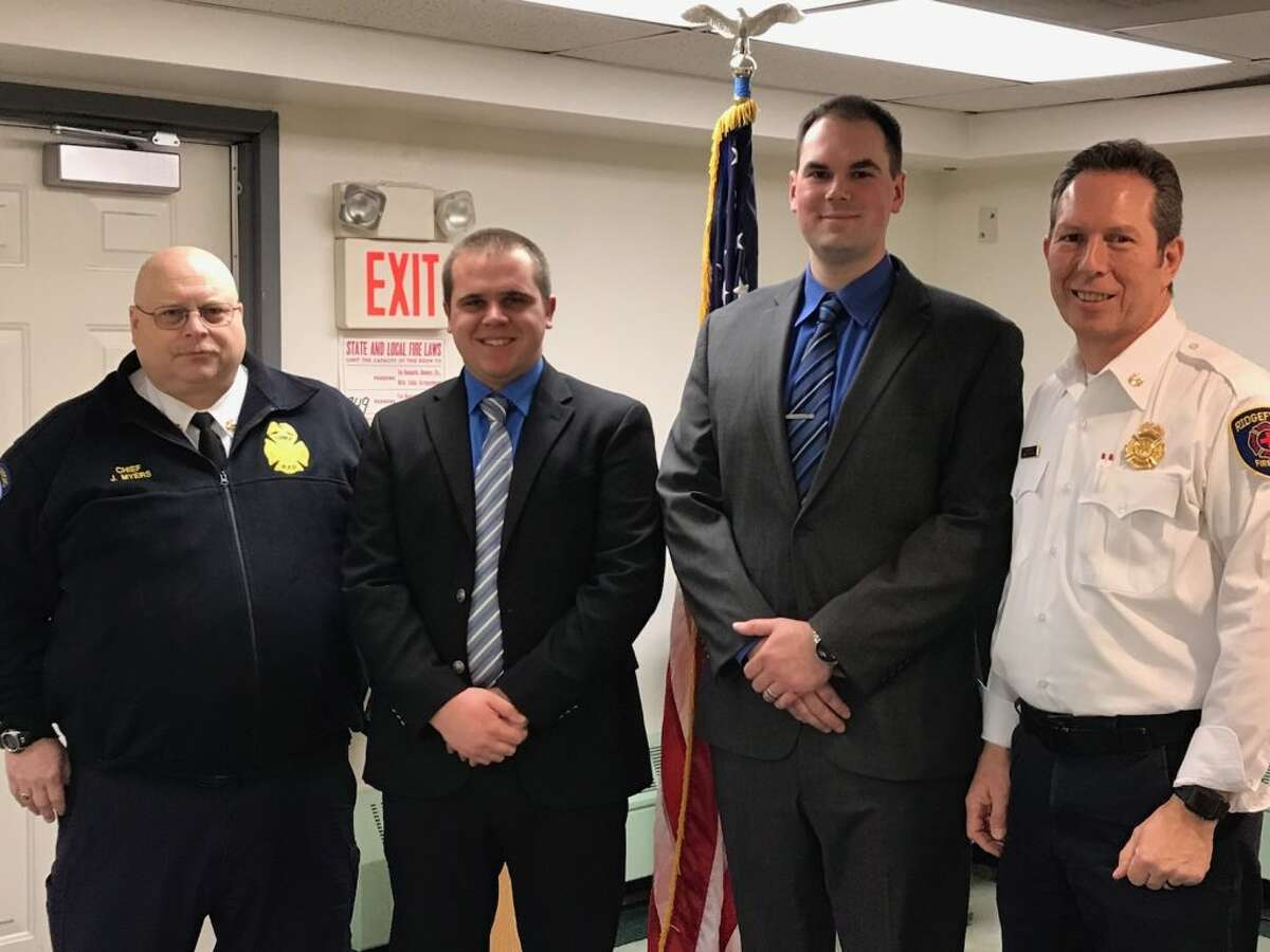 Ridgefield Fire Chief Jerry Myers, far left, and Assistant Fire Chief Mickey Grasso, far right, stands with the department's new hires, Seth Kellogg and Ryan Underwood.