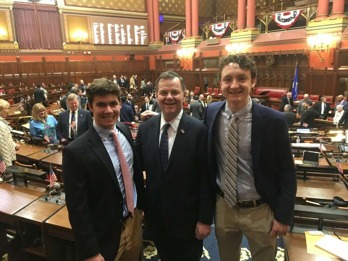 RHS seniors Alec Pool, left, and Miles Tullo, right, accompanied Rep. John Frey to the legislature's opening day, which included the swearing in of the new legislature and Gov. Ned Lamont's address. Pool and Tullo will be doing their senior internships at the state capitol with Rep. Frey this spring. The photo was taken in the Connecticut House Chambers Jan. 9, 2019.