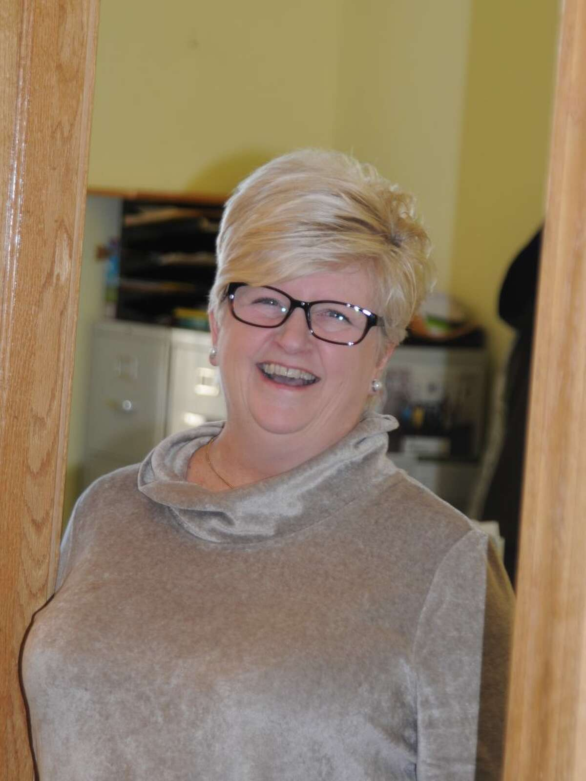 Karen Gaudian, the town's employee of the year, serves a variety of people working in the social services office. - Macklin Reid photo