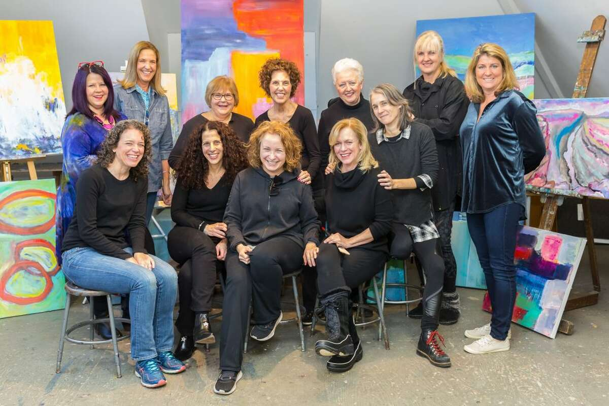 Abstract painters who are displaying their work at Sarah's Wine Bar through March 10 include, back row from left: Rhonda Gentry, Madyn Gwynn, Karen Beck, Kathleen Wrampe, Ruth van den Nieuwenhuizen and Jacque Lang. Front row from left: Dayna Sierakowski, Blair Crowley, Rachel Volpone (instructor), Tina Sturges, Michelle Briody. - Mary Harold photo