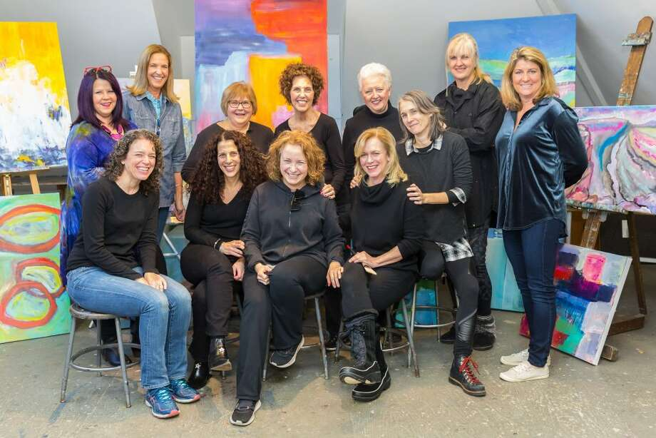 Abstract painters who are displaying their work at Sarah's Wine Bar through March 10 include, back row from left: Rhonda Gentry, Madyn Gwynn, Karen Beck, Kathleen Wrampe, Ruth van den Nieuwenhuizen and Jacque Lang. Front row from left: Dayna Sierakowski, Blair Crowley, Rachel Volpone (instructor), Tina Sturges, Michelle Briody. — Mary Harold photo
