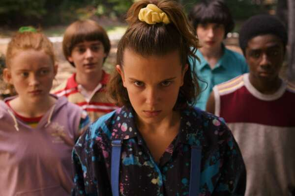 Eleven, complete with a very 1980s scrunchie, delivers a don't-mess-with-me glare.