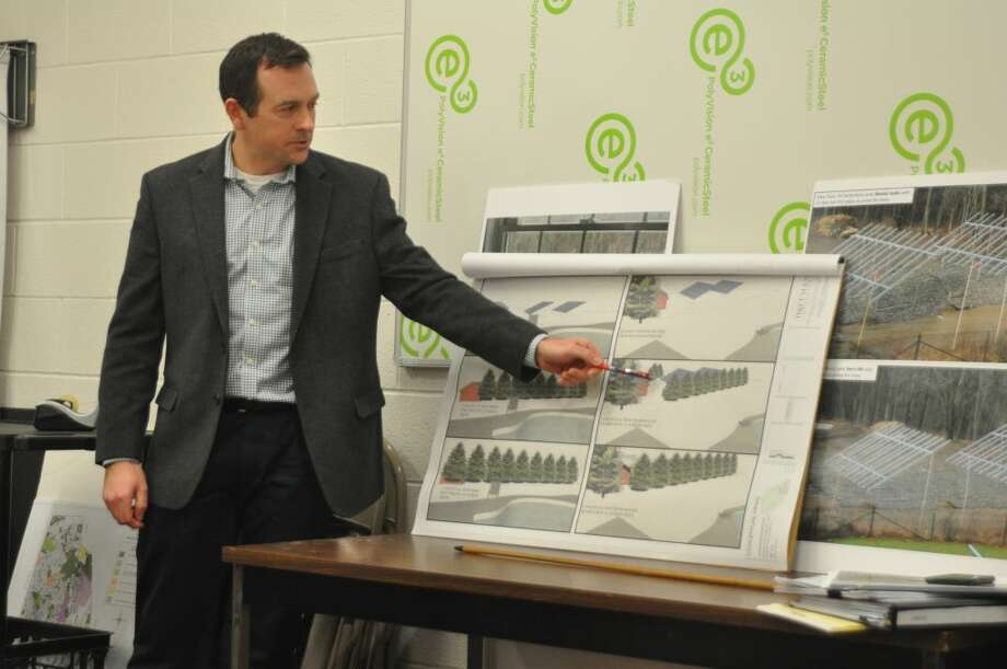 Landscape architect Brian Cossari of Hoffman Landscapes showed the Zoning Board of Appeals hearing how the disputed solar arrays might be screened with a row of evergreens. — Macklin Reid photo