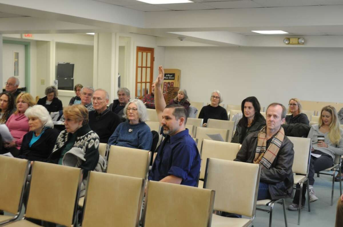 Michael Garguilo raises his hand to speak during Saturday's public hearing in town hall. - Macklin Reid photo