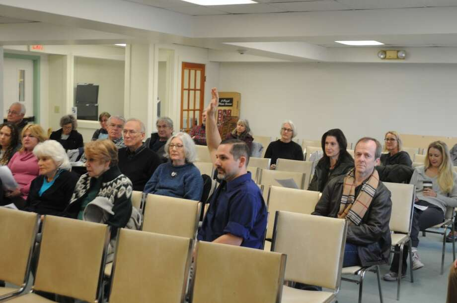 Michael Garguilo raises his hand to speak during Saturday's public hearing in town hall. — Macklin Reid photo
