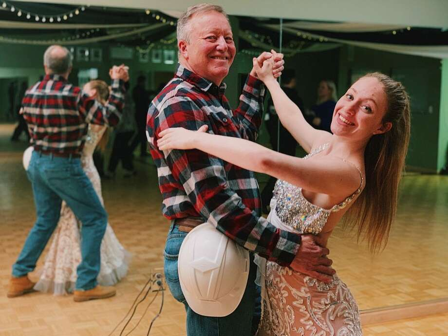 Dance instructor Samantha Lovetere, above, teaches Ridgefield resident Kent Rohrer, board chair at Housatonic Habitat for Humanity, how to salsa.