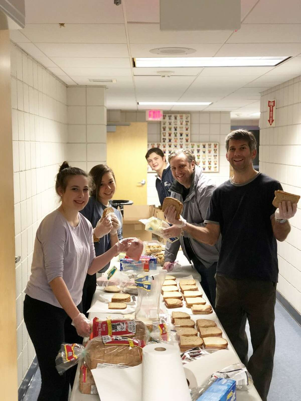 Project Heart Ridgefield members prepare sandwiches at St. Mary Church Friday, Dec. 21, before making a trip to New York City to help the homeless.