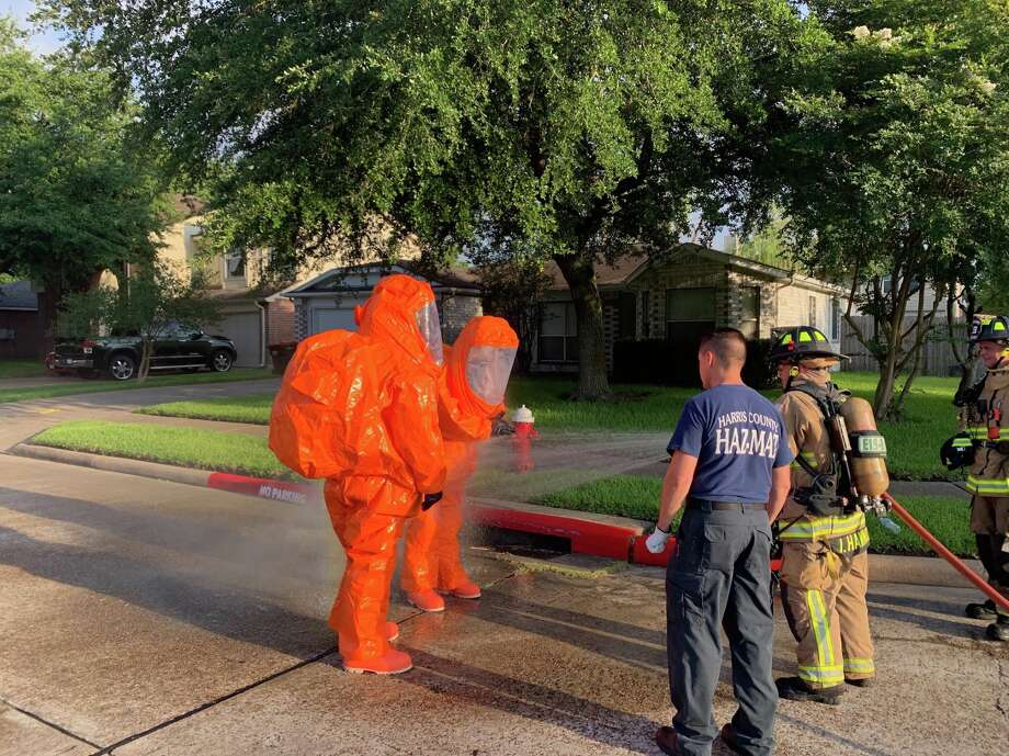 Firefighters wash down Harris County Fire Marshal's Office hazmat team members after a chlorine leak at a community pool in Atascocita on Tuesday, June 18, 2019. Photo: Harris County Fire Marshal's Office