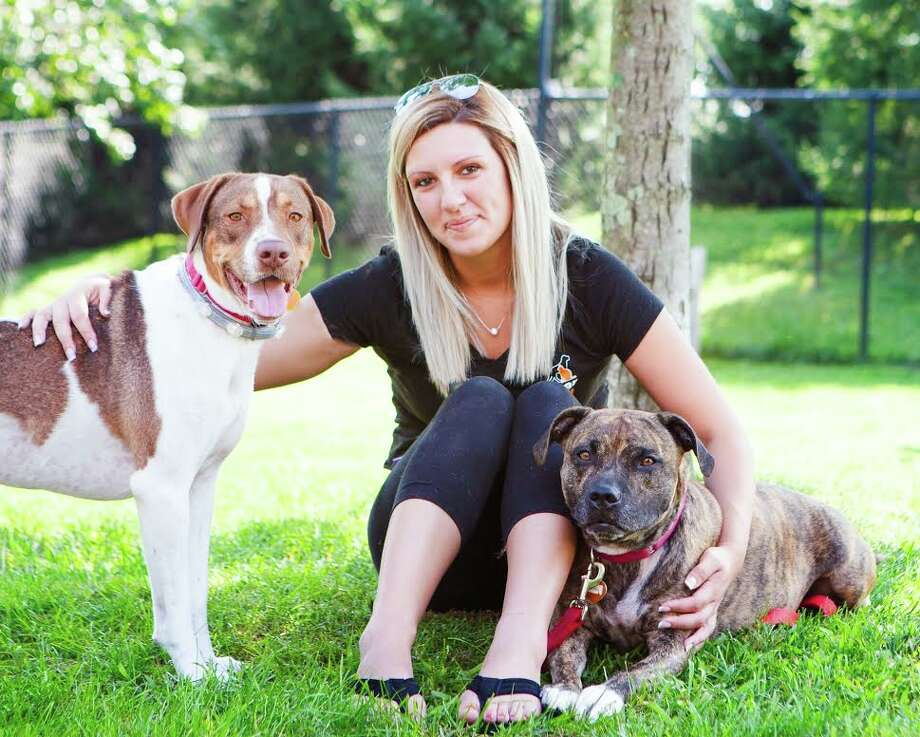 Sarah Roberts, ROAR's new adoption coordinator with Ranger (left) and Katie (right), two four-legged pals she hopes to have adopted together. Roberts was hired as the adoption coordinator on July 16. — Debbie Rabinowitz photo