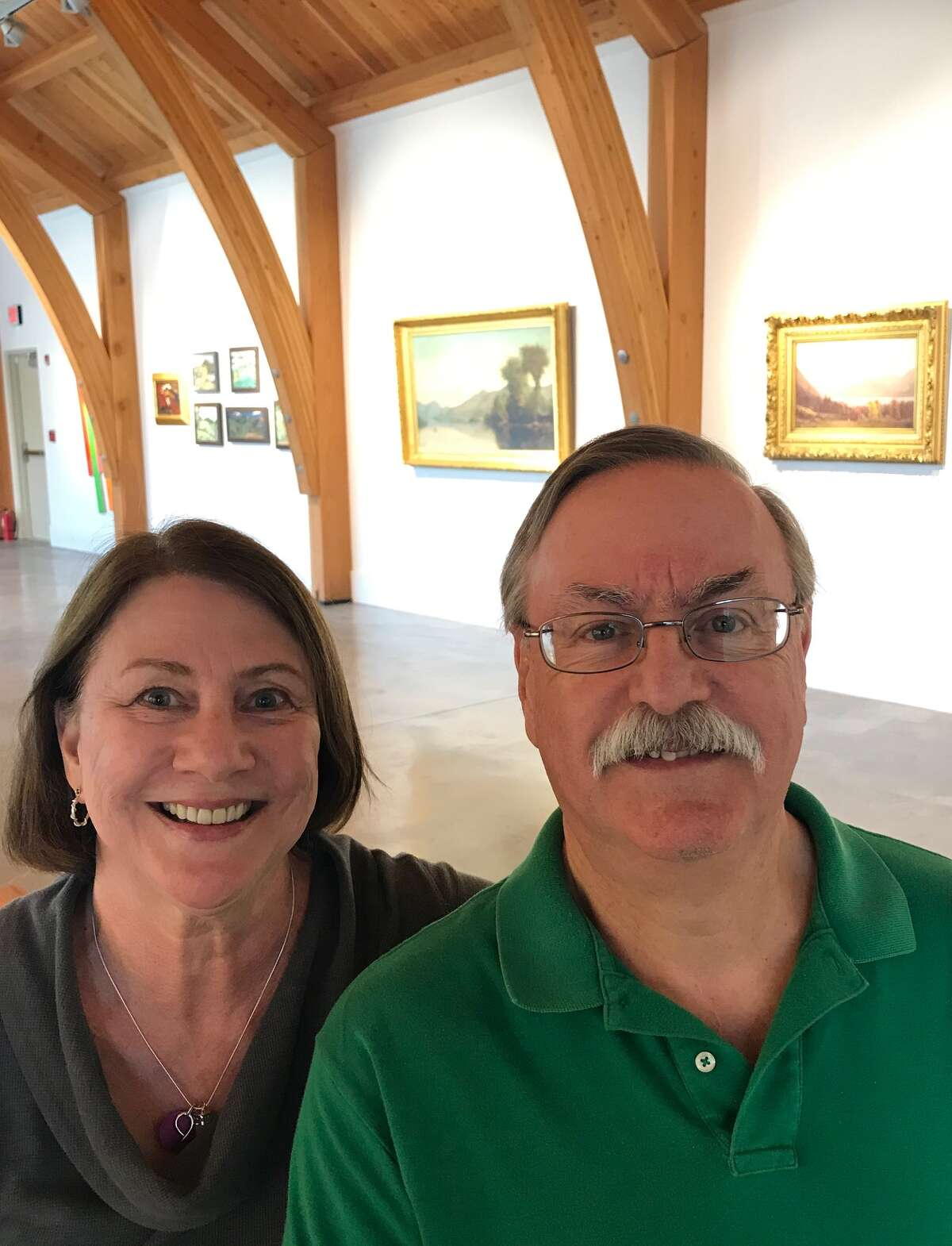 Jeanne and Bernie Brown, who helped curate the new exhibit, Landscapes Lost and Found: Two Centuries of Art from Bolton Landing at the Bolton Historical Museum