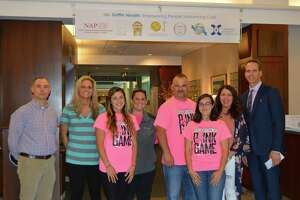 Members of the Derby High School Girls Softball team presented Griffin Hospital President and CEO Patrick Charmel with a $2,500 donation to The Hewitt Center for Breast Wellness at Griffin Hospital. Pictured in front from left: Derby High Softball players Lacey DiMartino and Anna Chevarella. Pictured in back from left: Derby High School Athletic Director Matt Bradshaw, Derby High School Assistant Softball Coach Alyssa Goggi, Derby High School's Softball Team Co-Captain Cristina Carloni, Derby High School Assistant Softball Coach Lindsay Wheeler, Derby High Softball Coach Joe DiMartino, Derby High School's Softball Team Co-Captain Ivana Coutinho, Laura DiMartino; and Charmel.