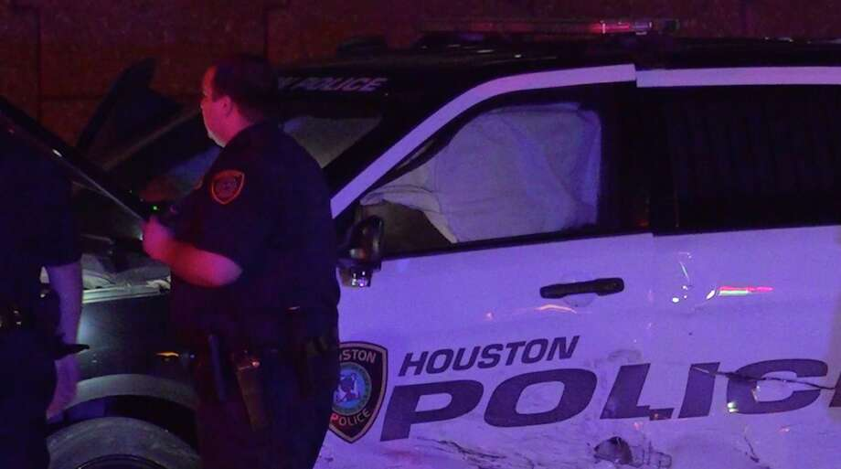 Houston police officers investigate an officer-involved crash on the West Sam Houston Parkway feeder road at Hammerly on Tuesday, June 18, 2019. Photo: OnSceneTV