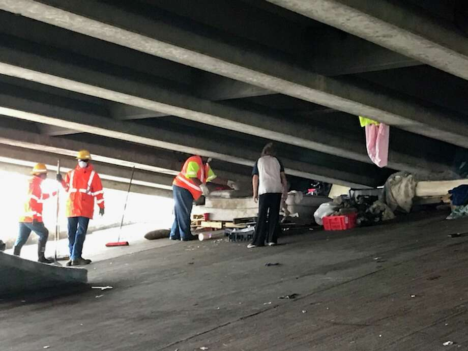 The Harris County Sheriff's Office partnered with the Texas Department of Transportation to clear a homeless camp under the I-10 overpass on Sheldon Road. This is what it looked like before and after the cleanup. Photo: Harris County Sheriff's Office
