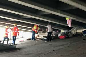 The Harris County Sheriff's Office partnered with the Texas Department of Transportation to clear a homeless camp under the I-10 overpass on Sheldon Road. This is what it looked like before and after the cleanup.