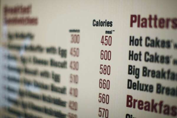 FILE - In this July 18, 2008 file photo, calories of each food item appear on a McDonalds drive-thru menu in New York. Calorie counts will have to be listed on restaurant menus under a provision tucked into the massive health care overhaul bill. (AP Photo/Ed Ou, File)