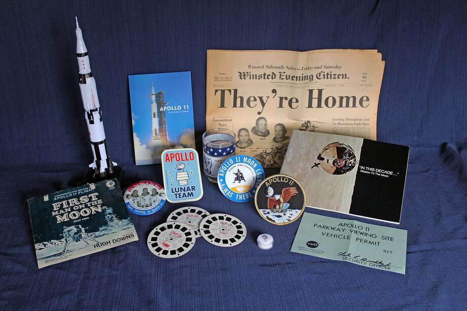 """To celebrate the IMAX movie """"Apollo 11: First Steps Edition"""" and the 50th anniversary of the first mission to the moon, The Maritime Aquarium at Norwalk will display a collection of memorabilia relating to Apollo 11 in July and August. Items — a portion of which are shown here — include newspapers from the day, buttons, patches, rocket models, a book signed by astronaut """"Buzz"""" Aldrin, collectibles, NASA documents and a piece of the moon itself: a tiny lunar meteorite. Photo: Maritime Aquarium / Contributed Photo"""