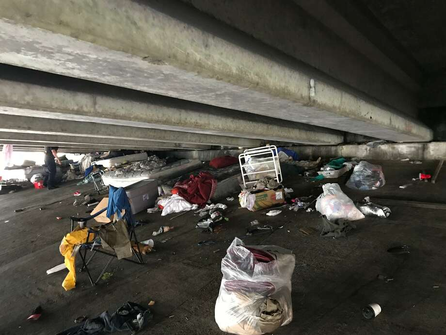 The Harris County Sheriff's Office partnered with the Texas Department of Transportation to clear a homeless camp under the I-10 overpass on Sheldon Road. >>>This is what it looked like before and after the cleanup  Photo: Harris County Sheriff's Office