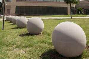 Large cement spheres line the property surrounding the Midland County Courthouse. 06/18/19  Tim Fischer/Reporter-Telegram