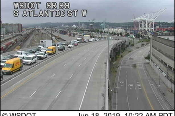Traffic backs up northbound on state Route 99 after a motorcycle and car collision at the entrance to the SR-99 tunnel.