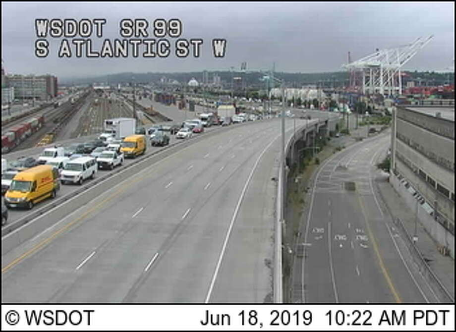 Traffic backs up northbound on state Route 99 after a motorcycle and car collision at the entrance to the SR-99 tunnel. Photo: Washington State Department Of Transportation