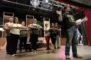 "Eli Patton, as ""Watchdog"" Melvin P. Thorpe, leads the Angelettes during a rehearsal for ""The Best Little Whorehouse in Texas"" at Brookfield Theatre for the Performing Arts. The show will be onstage June 28 through July 20."